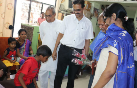 Samir Ghosh interacting with a child with deformity, who approached Nagai Narayanji Memorial Foundation for corrective surgery, Nagpur, Apr 2019